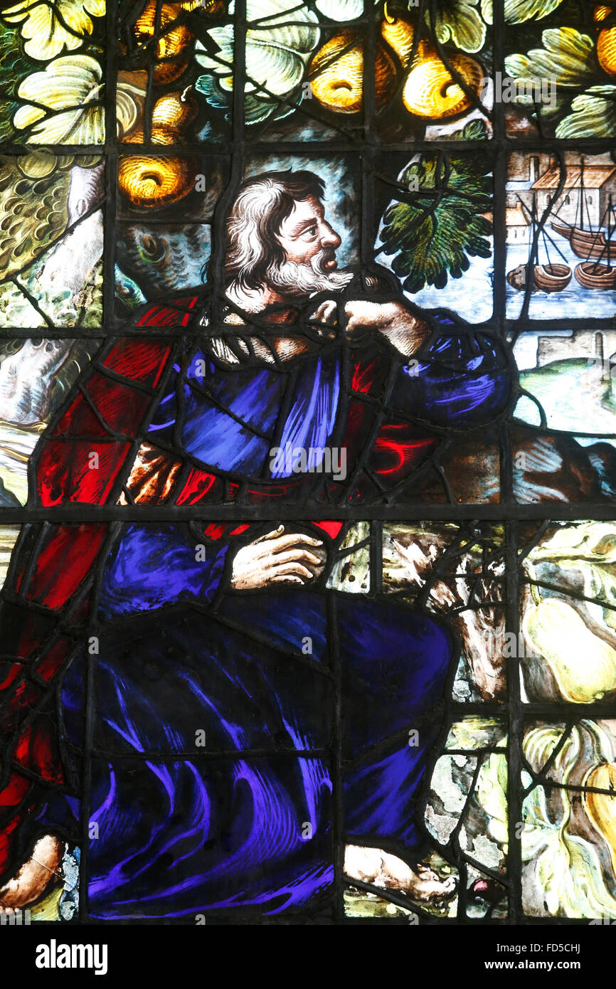 Oxford's Cathedral at Christ Church college, Oxford. Stained glass window. Adam. - Stock Image
