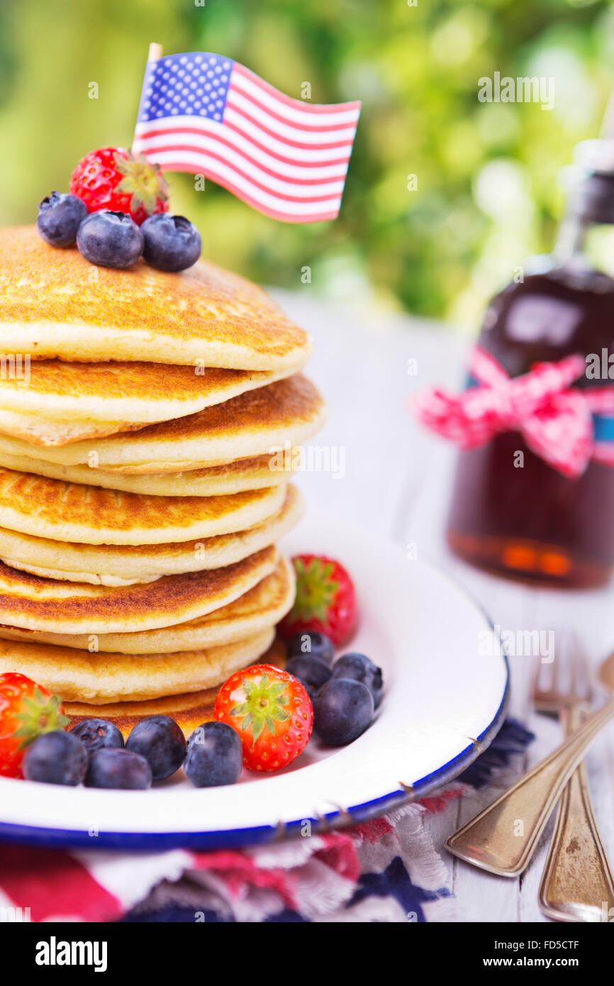 A stack of homemade pancakes with fresh fruit. - Stock Image