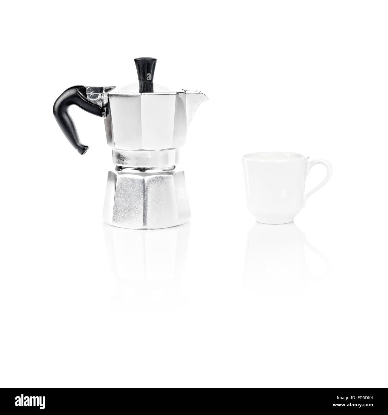 Moka Pot, also known as stove top espresso machine italian coffee maker and a coffee cup on white background and - Stock Image