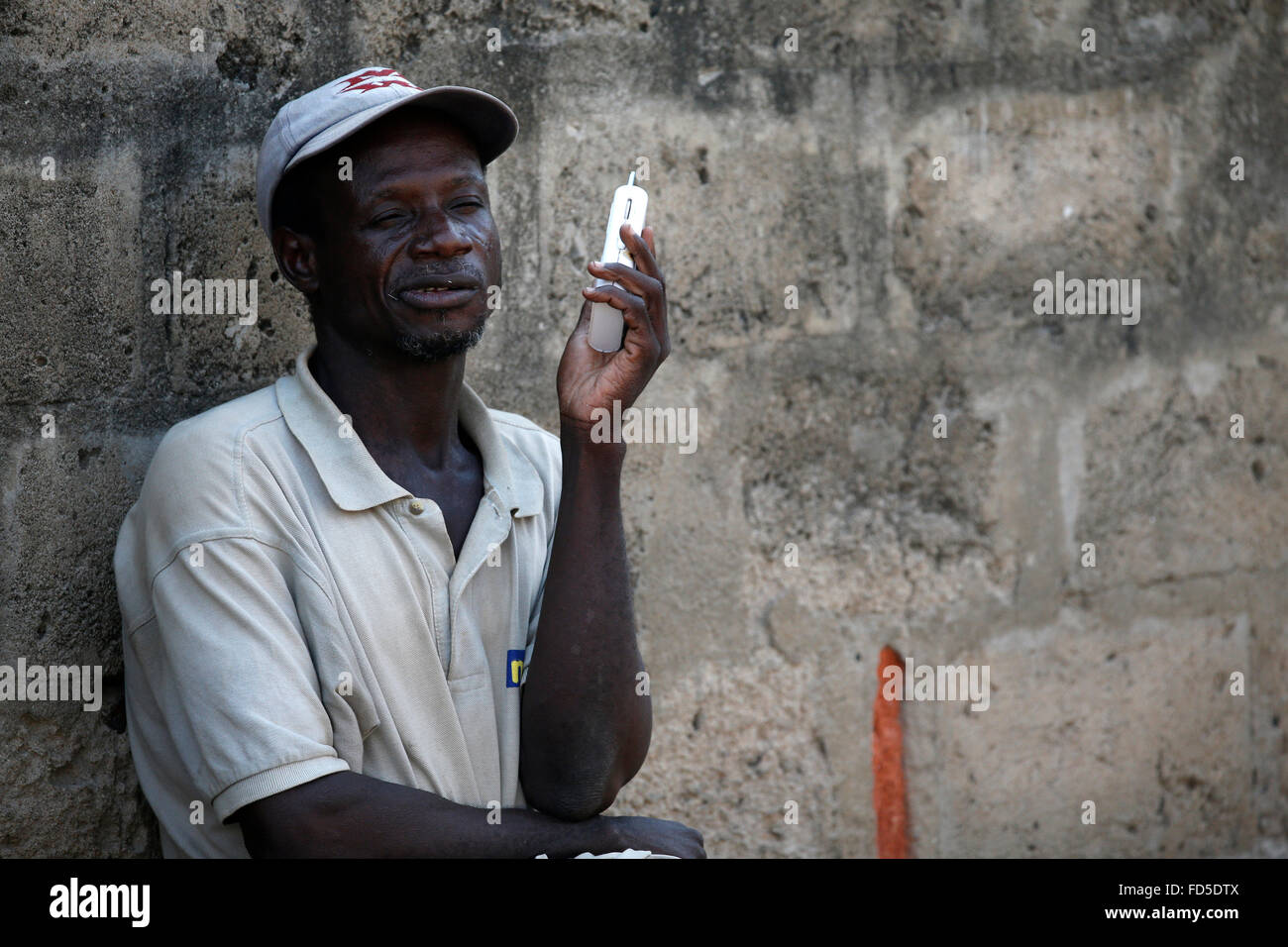 African man listening to the radio. - Stock Image
