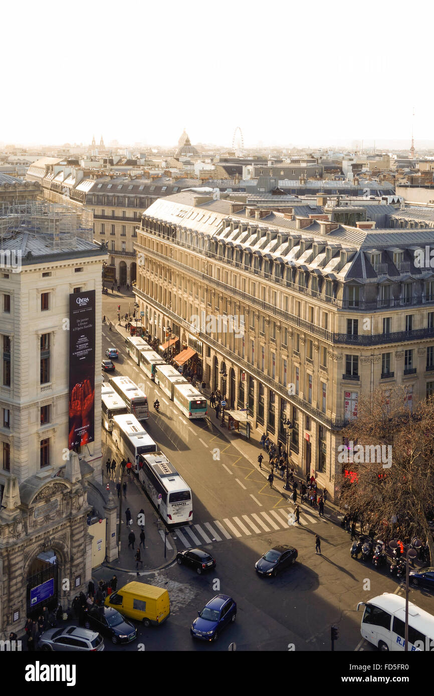 Traffic with Bus stop at Rue Scribe, opera of Paris, from roof terrace Galleries Lafayette, Paris, France. - Stock Image