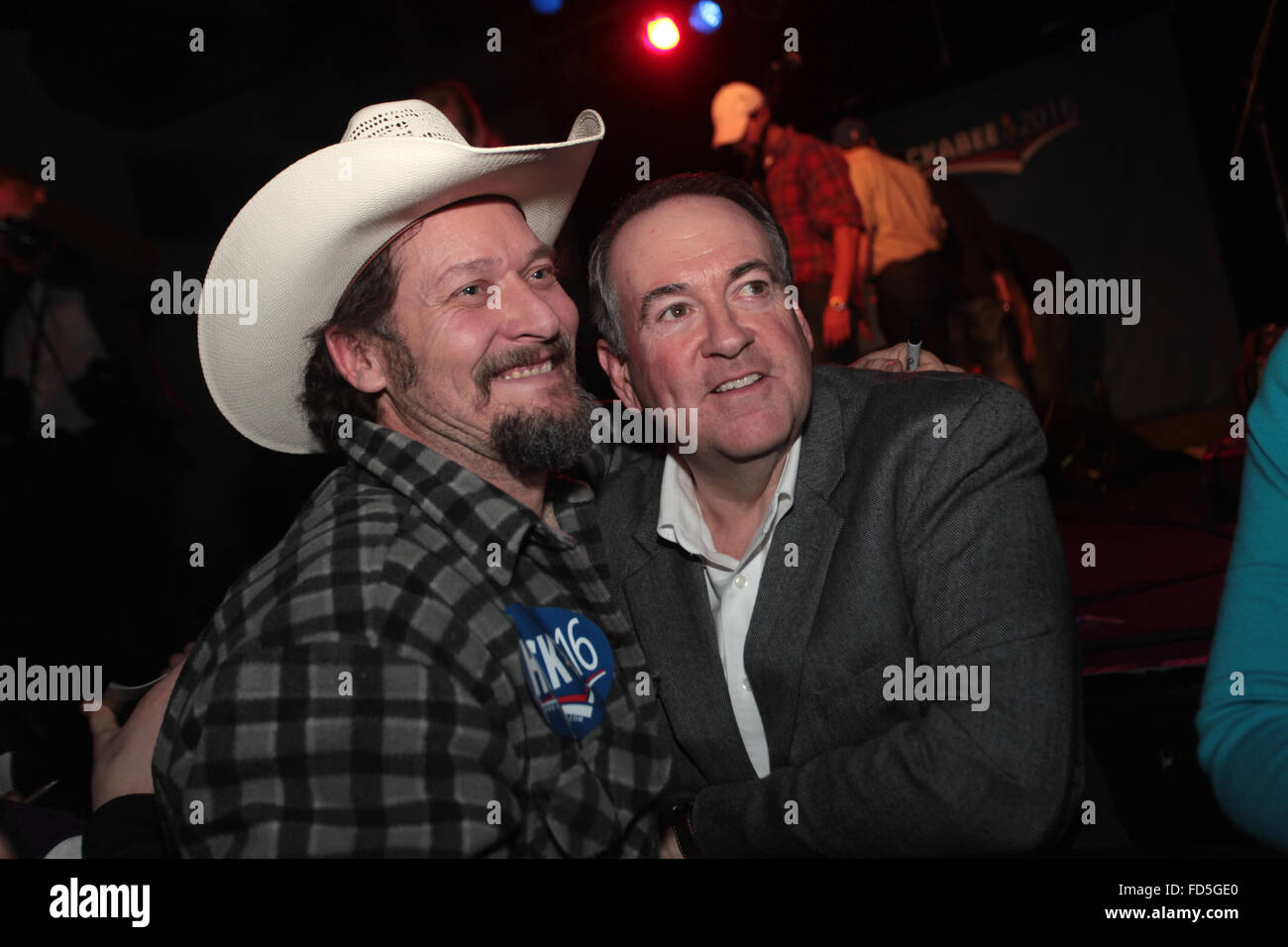 Former Gov. and GOP presidential candidate Mike Huckabee poses with a supporter during a campaign rally featuring - Stock Image