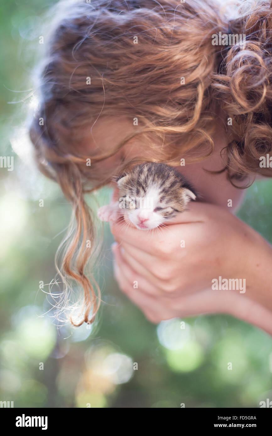 Woman Holding Kitten - Stock Image