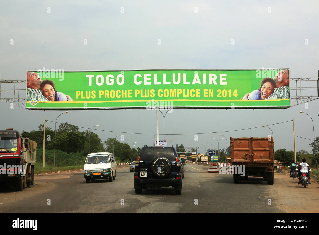 Traffic and Advertising for 'Togo Cellular, closer, more complicit in 2014.' - Stock Image