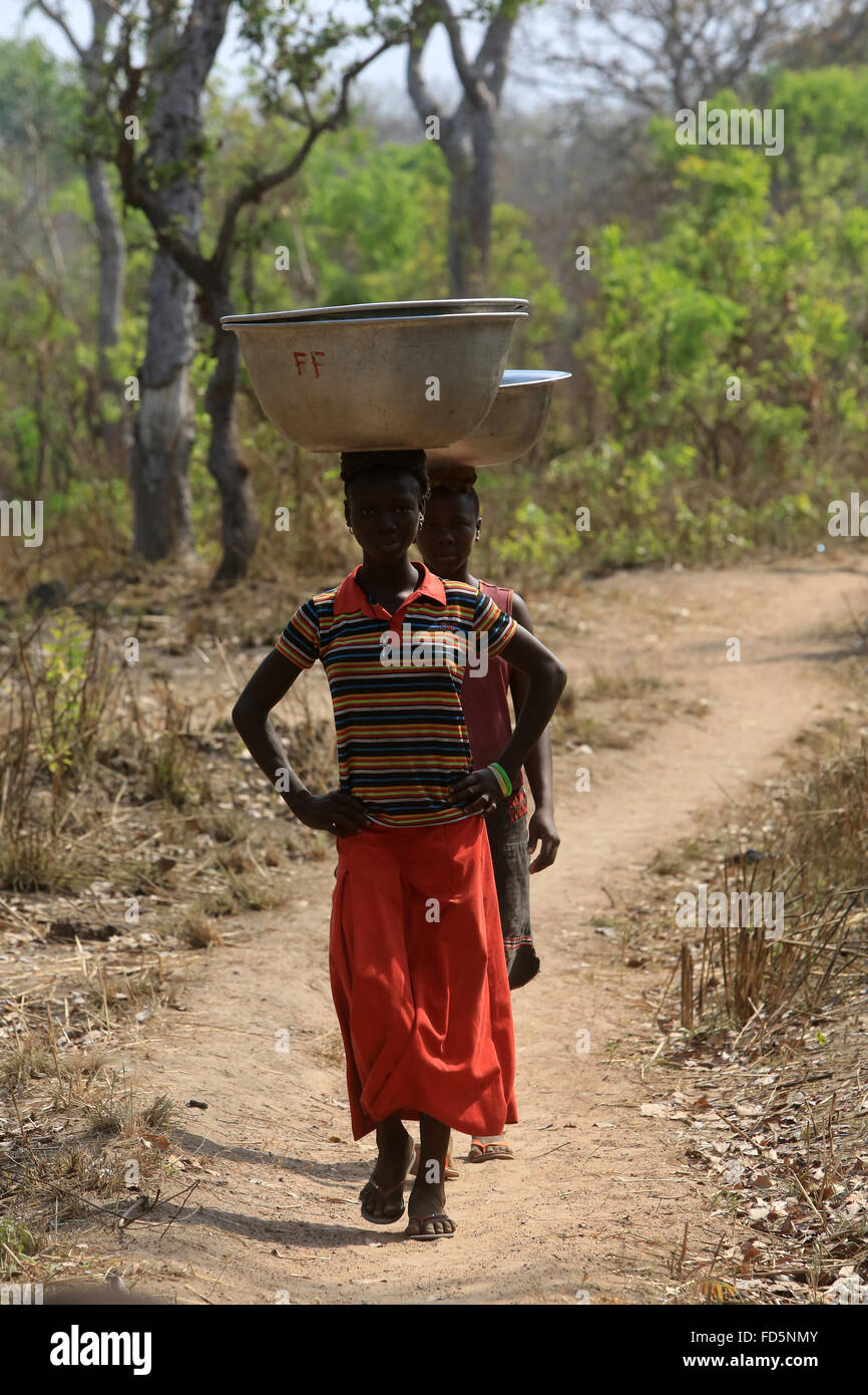 Africans girls fetching water. - Stock Image