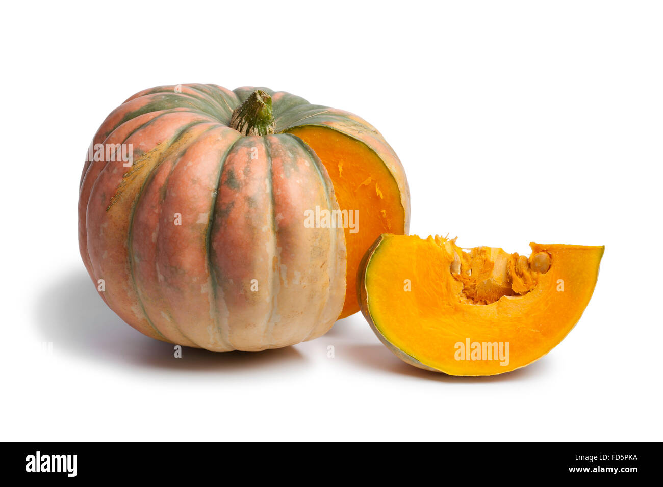 Fresh Speckled hound pumpkin and a piece on white background - Stock Image