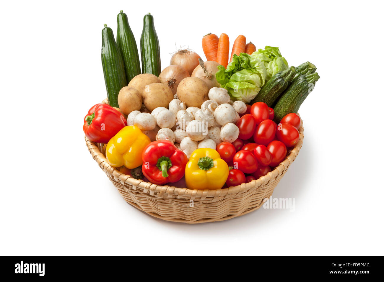 Basket with fresh vegetables on white background - Stock Image