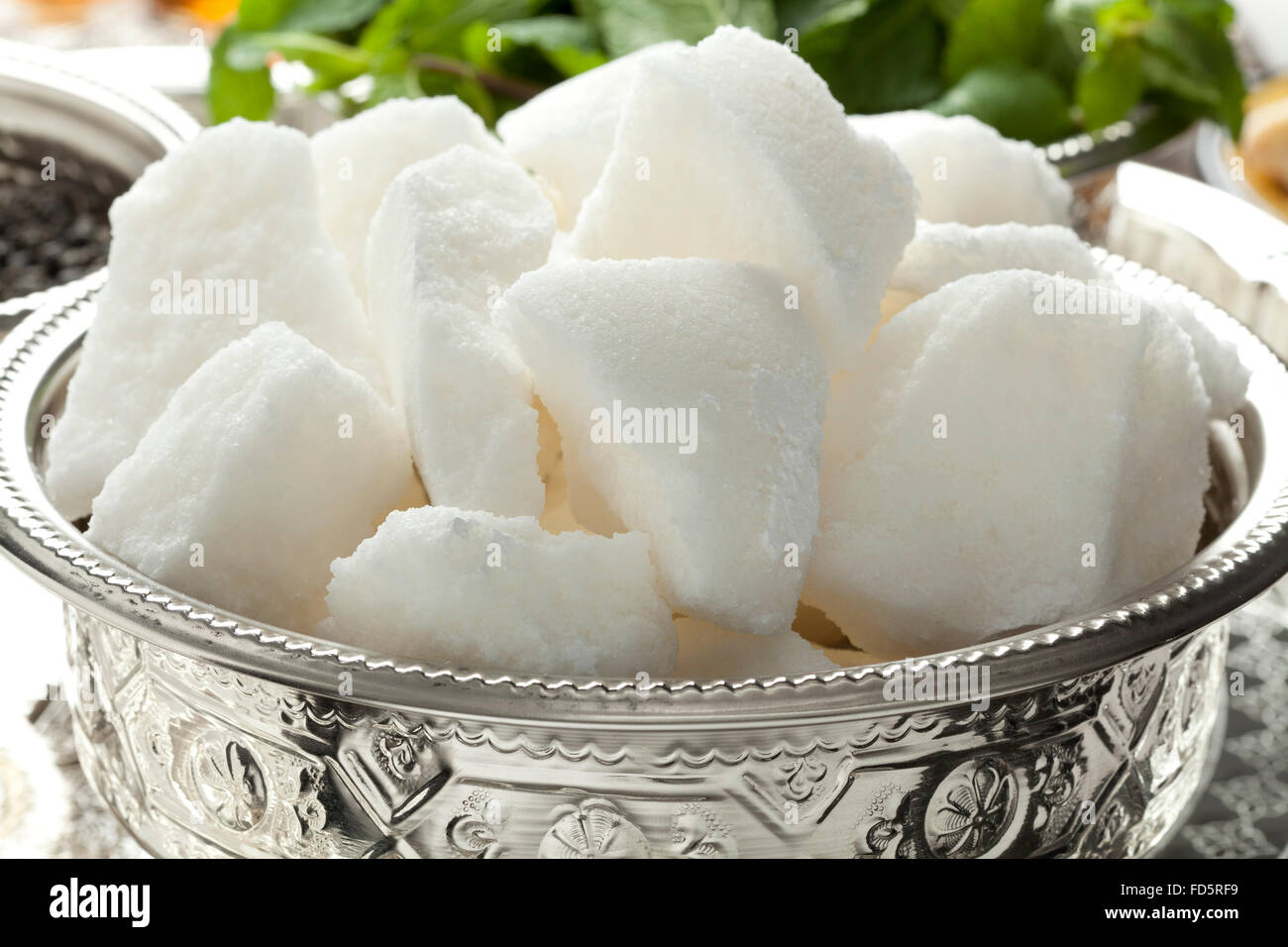 Traditional Moroccan bowl with pieces of sugar - Stock Image