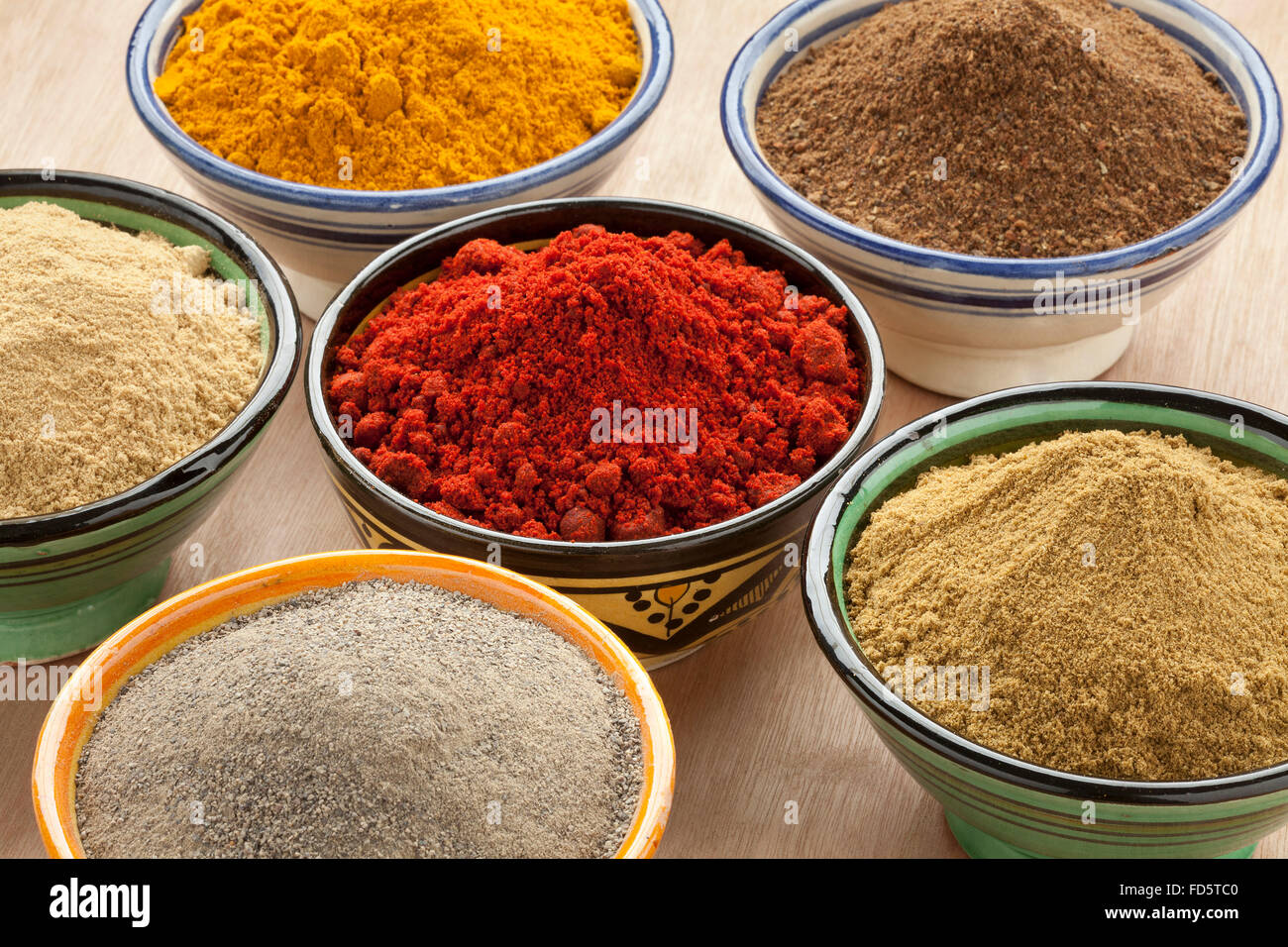 Moroccan bowls with different ground spices - Stock Image