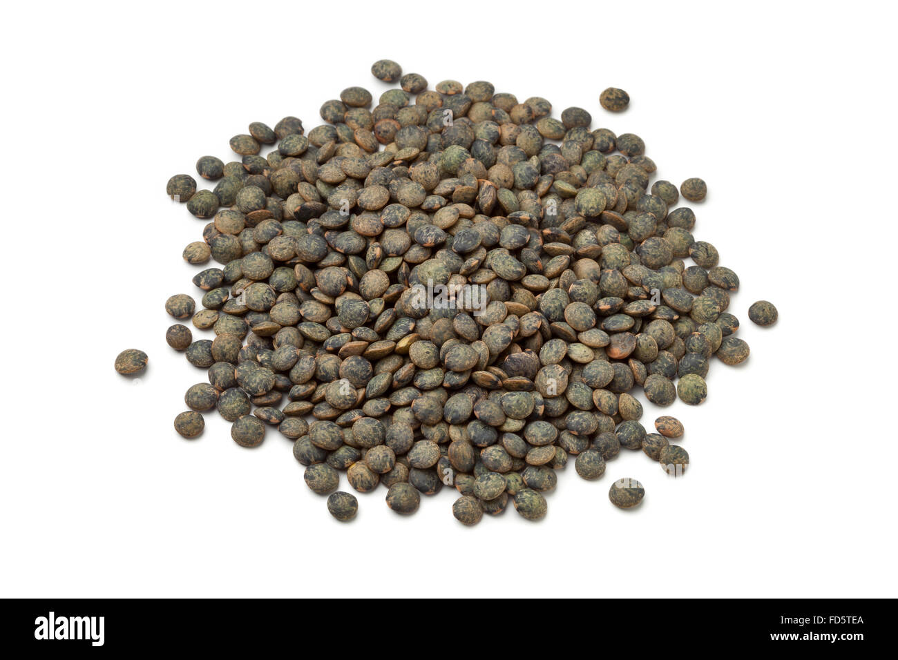 Heap of dried du Puy lentils on white background - Stock Image