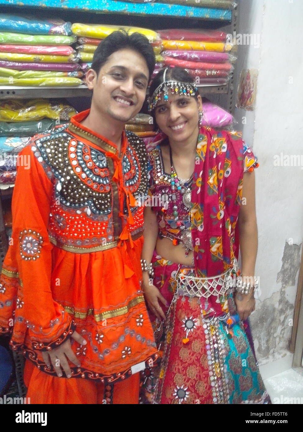 Portrait Of Happy Young Couple Wearing Traditional Clothe While Standing In Shop - Stock Image