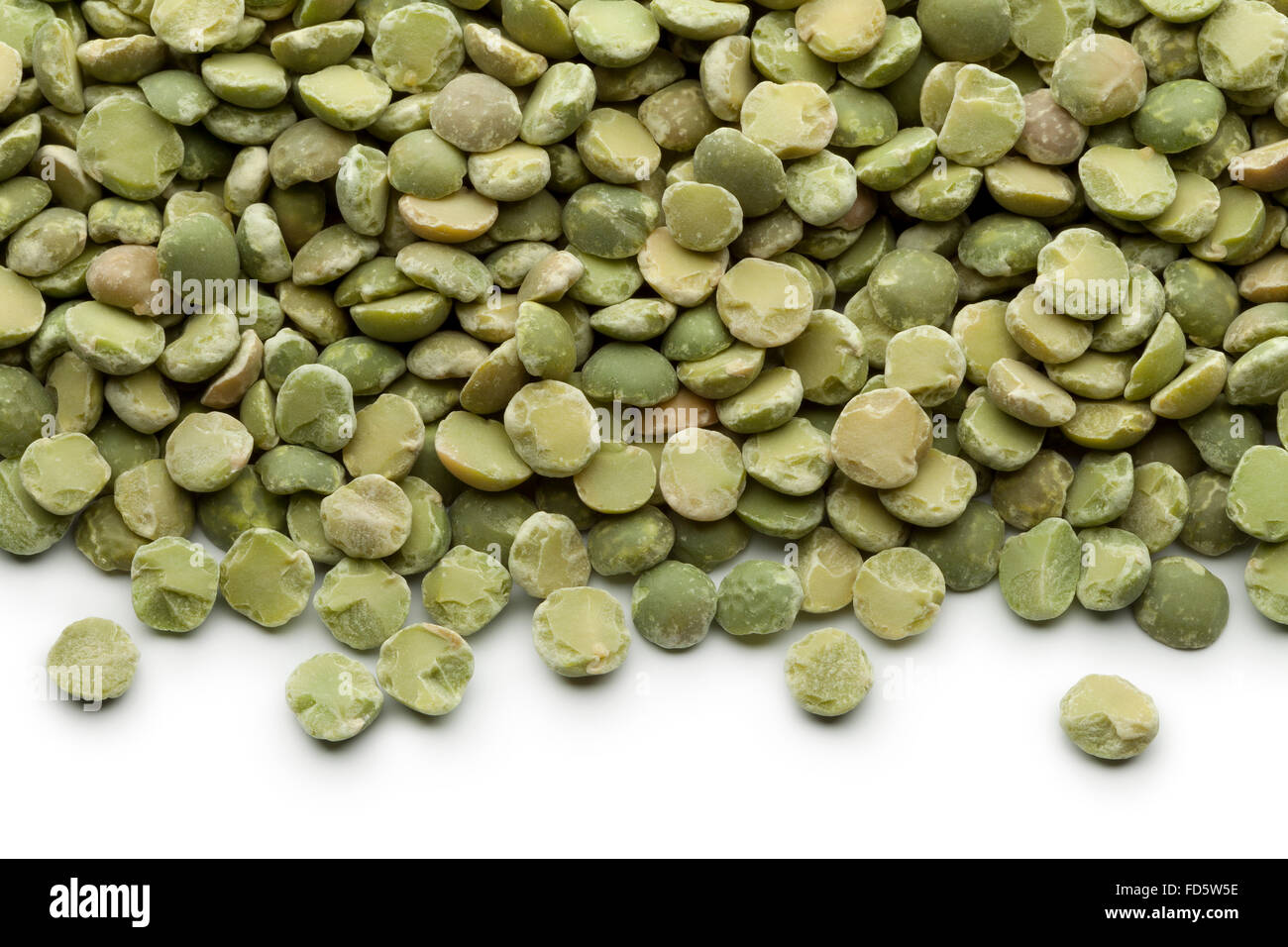 Scattered dried green split peas - Stock Image