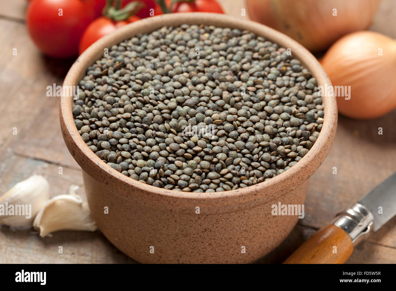 Dried Du Puy lentils in a bowl - Stock Image