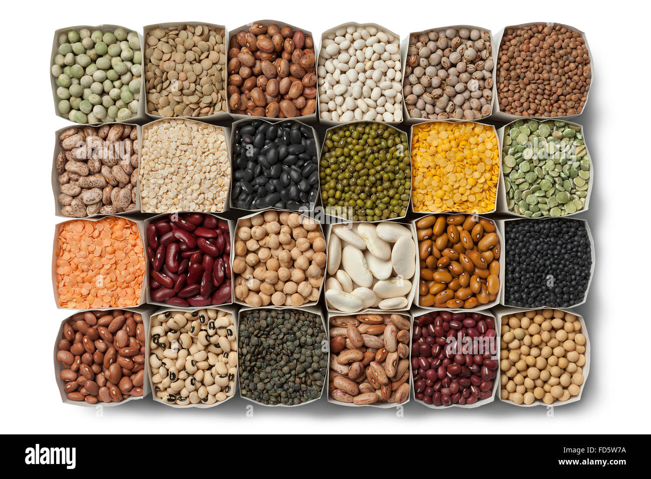 Variety of dried beans and lentils in bags on white background - Stock Image