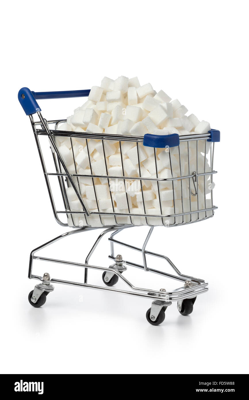 Shopping cart with sugar cubes on white background - Stock Image