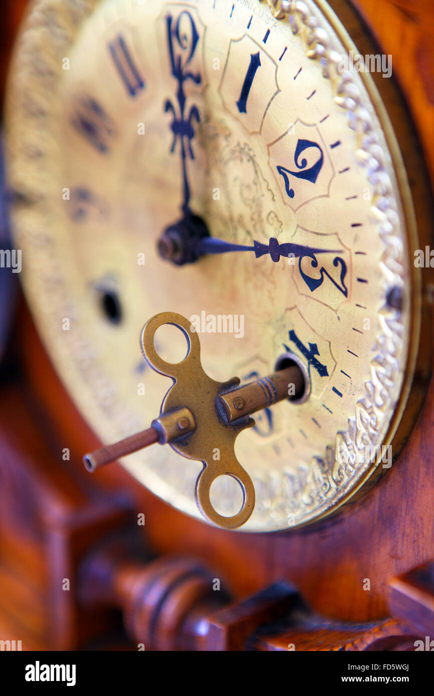 Key on the face of a 19th century oak mantle clock - Stock Image
