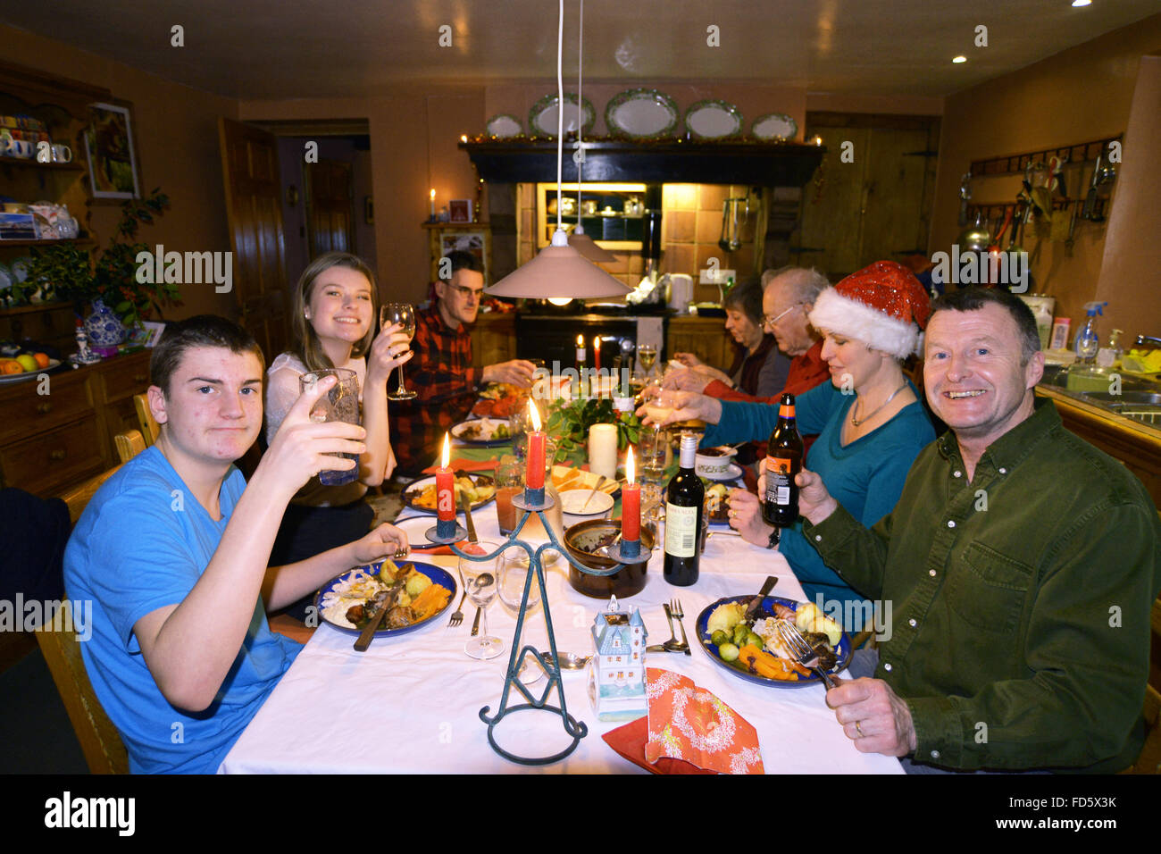 Traditional Christmas dinner for the family, 3 generations eat together turkey and all the trimmings. UK - Stock Image