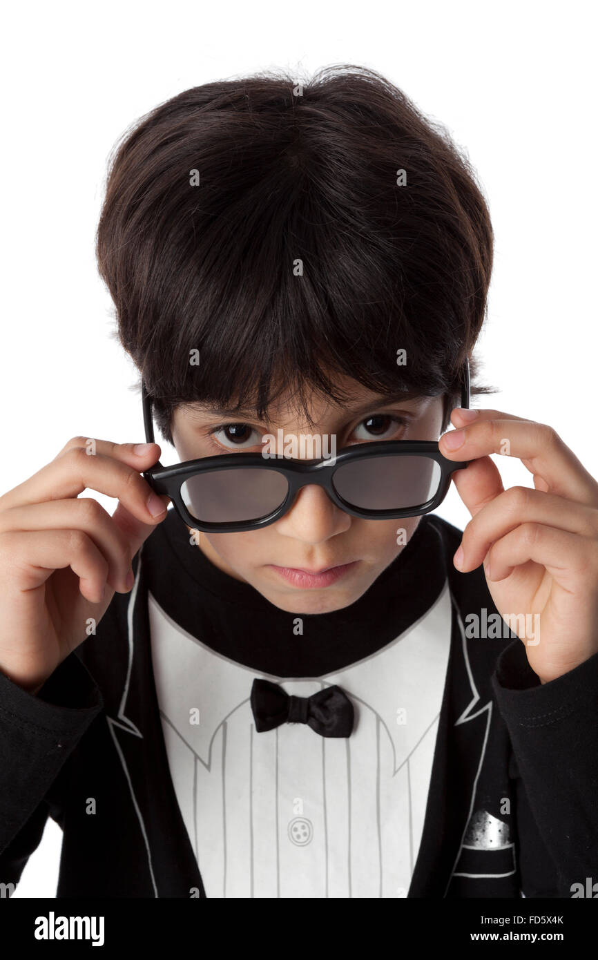 Well dressed eight year old boy  with sunglasses on white background - Stock Image