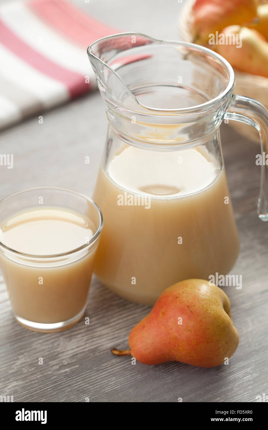 Fresh pear juice in a jar - Stock Image
