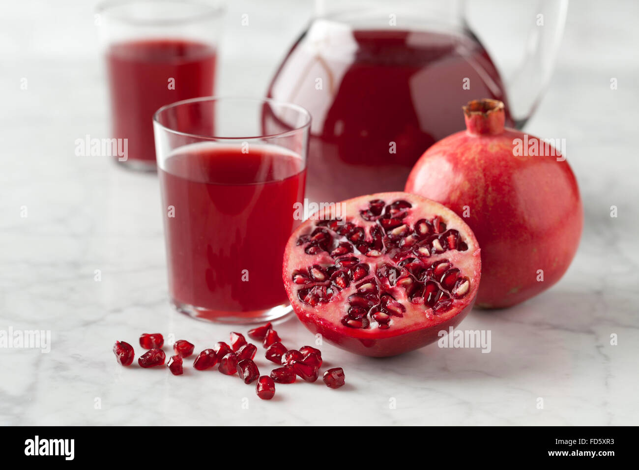Fresh pomegranate juice in a jar - Stock Image