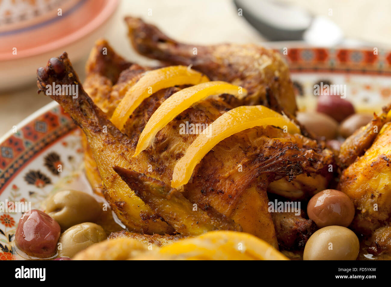 Moroccan chicken dish with preserved lemon and olives - Stock Image