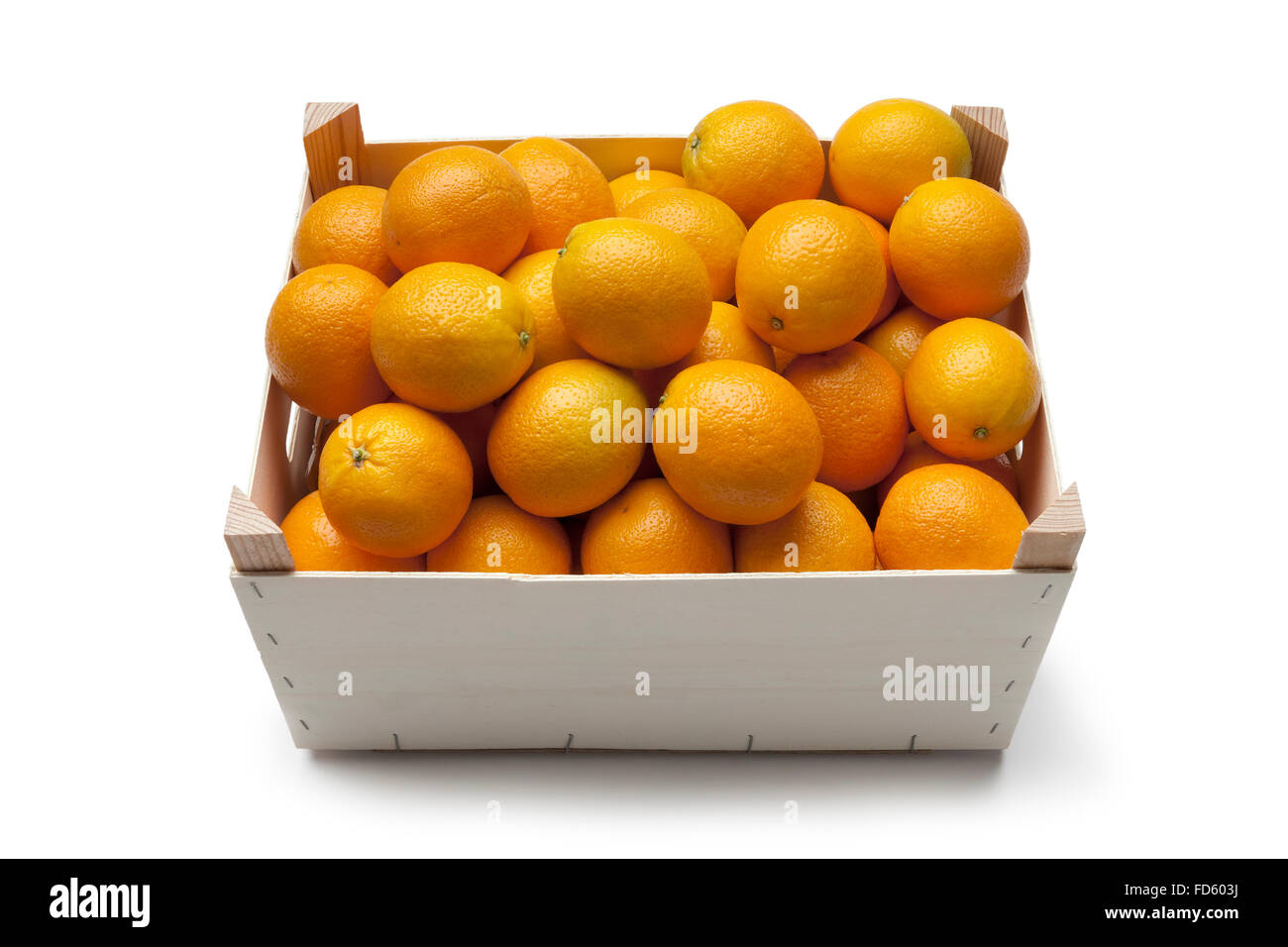 Fresh oranges in a container on white background - Stock Image