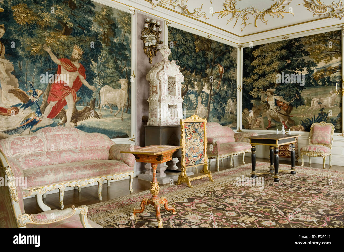 Elaborate tapestry with sofas in Gobeline room of Schloss Fasanerie near Fulda in Germany - Stock Image