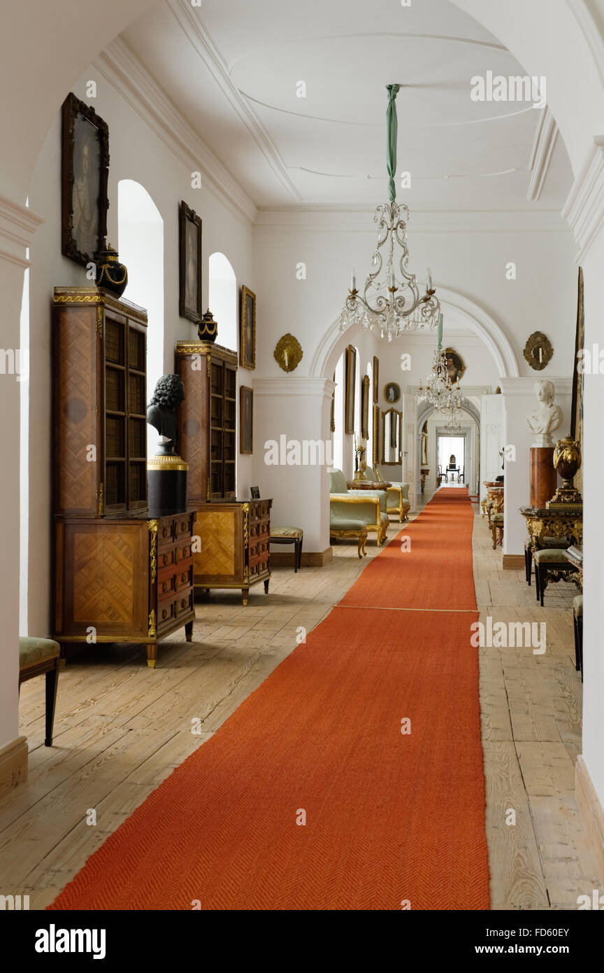 Red Carpet Runner With Antique Display Cabinets In Hallway