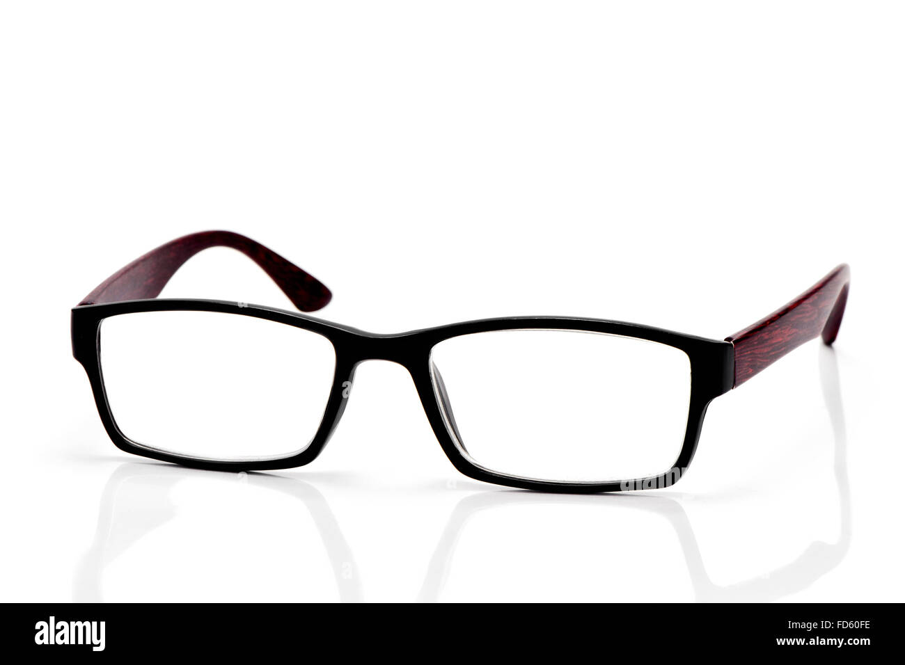 closeup of a pair of plastic and wooden rimmed eyeglasses on a white background - Stock Image