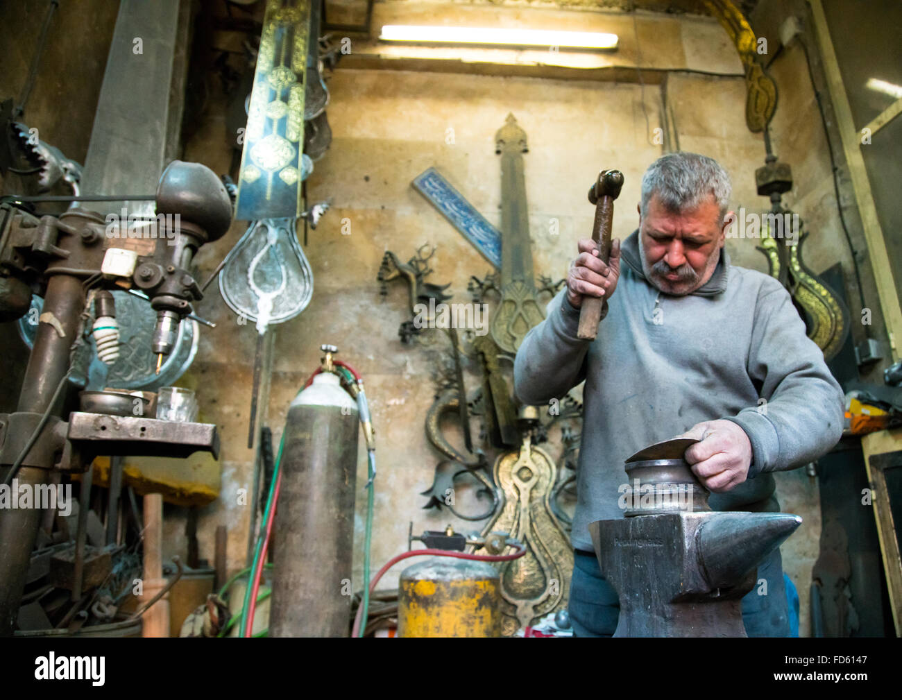 master safar fooladgar creating an alam in his workshop, Central district, Tehran, Iran - Stock Image