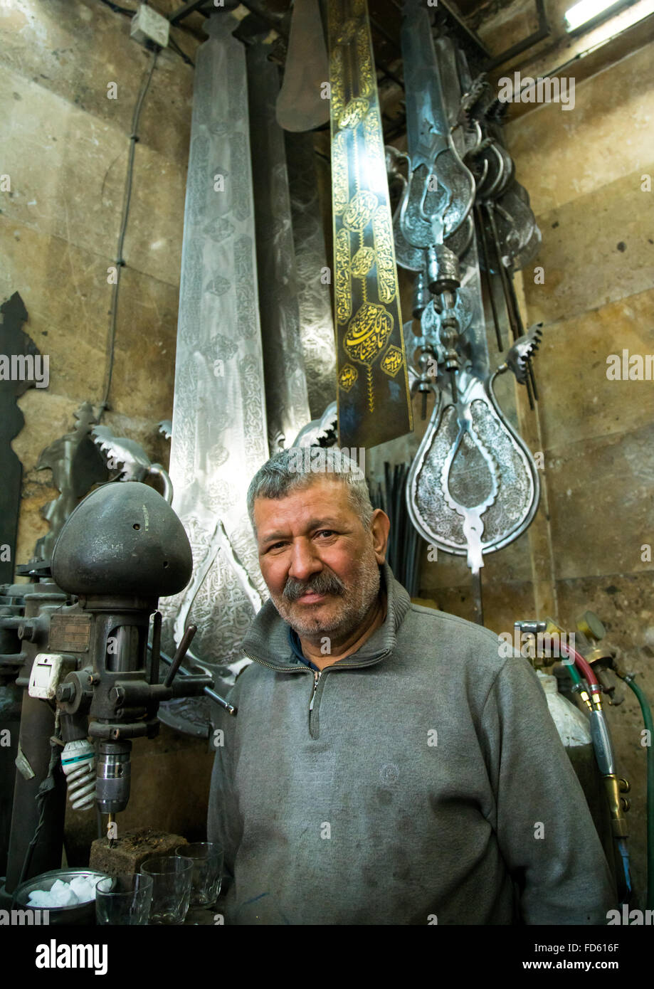 alam master safar fooladgar in his workshop, Central district, Tehran, Iran - Stock Image