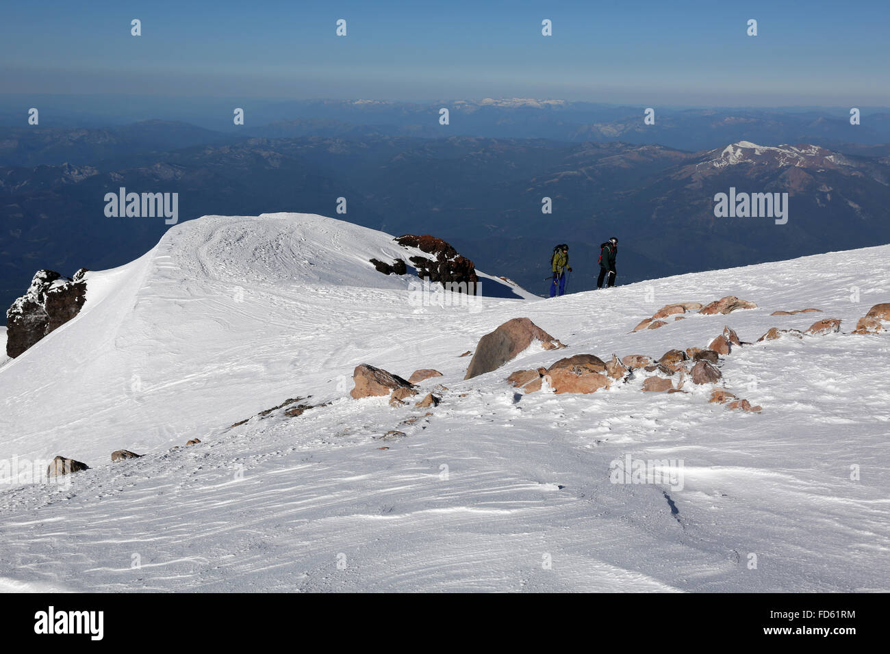 "CALIFORNIA - Climbers cresting ""Misery Hill"" and approaching the final ascent to the summit of 14,612-foot Mount Stock Photo"