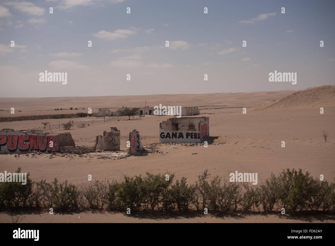 Demolished Buildings On Desert Landscape - Stock Image