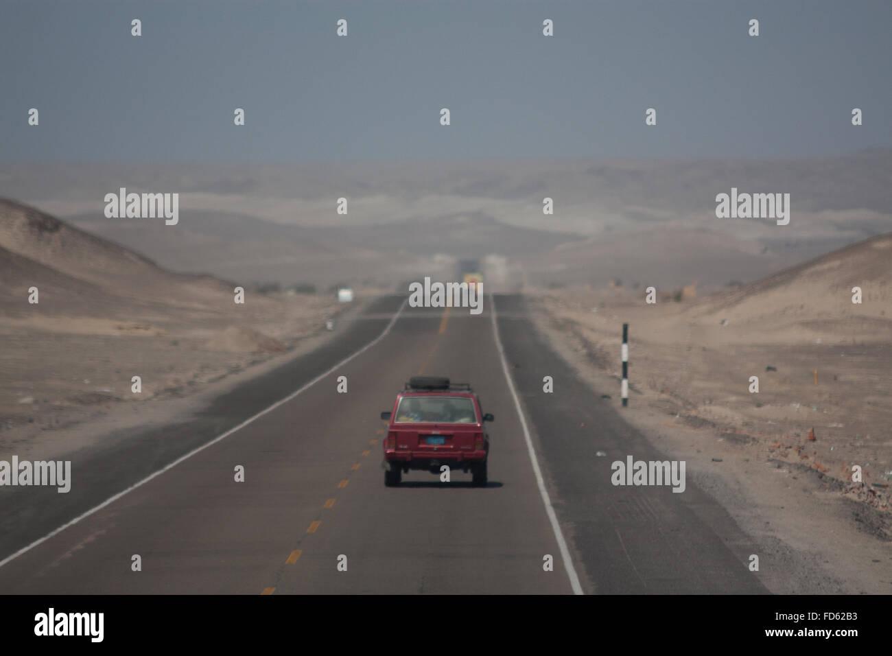Car On Desert Road - Stock Image