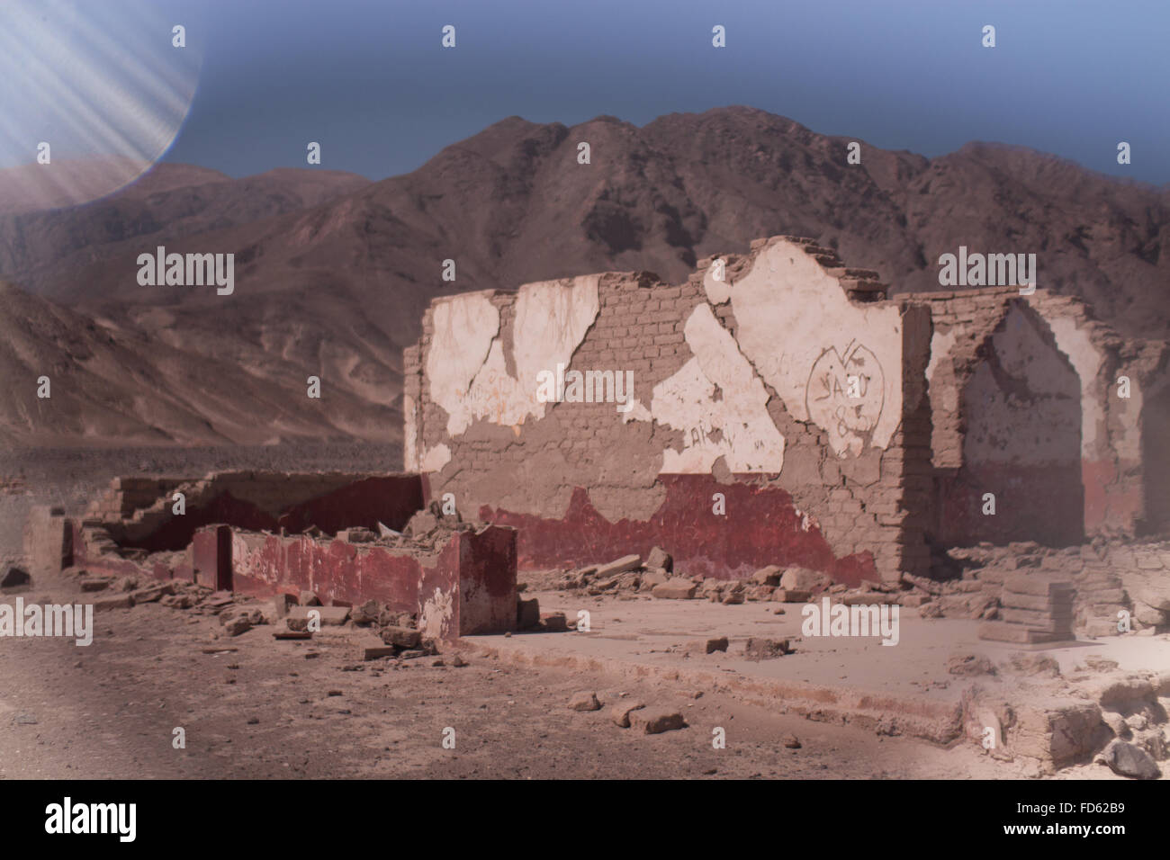 Demolished Building With Mountain In Background - Stock Image