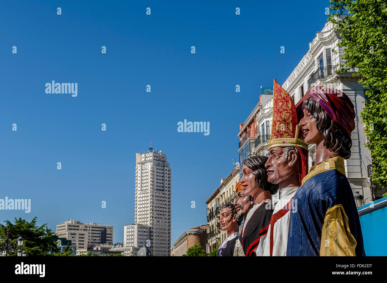View of a giant models near of Madrid tower, Madrid city, Spain - Stock Image