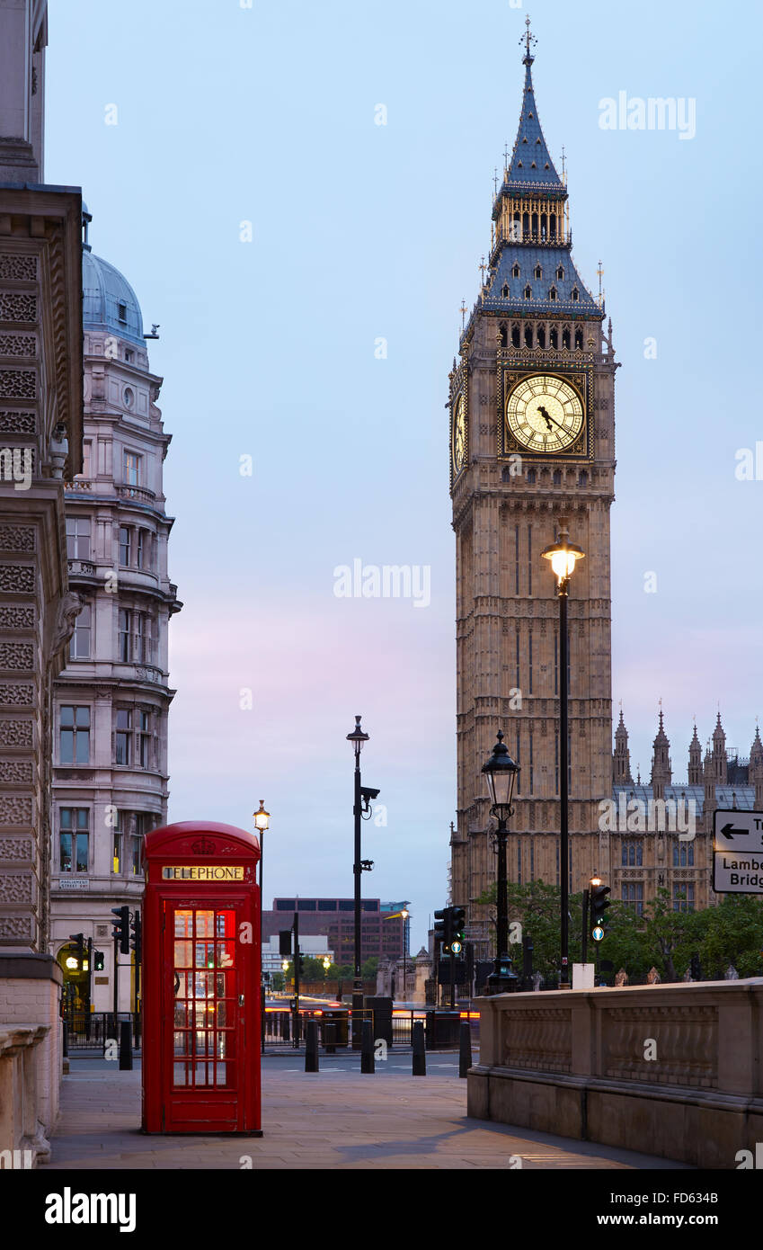 Big Ben and red London call box in the early morning, natural colors and lights - Stock Image