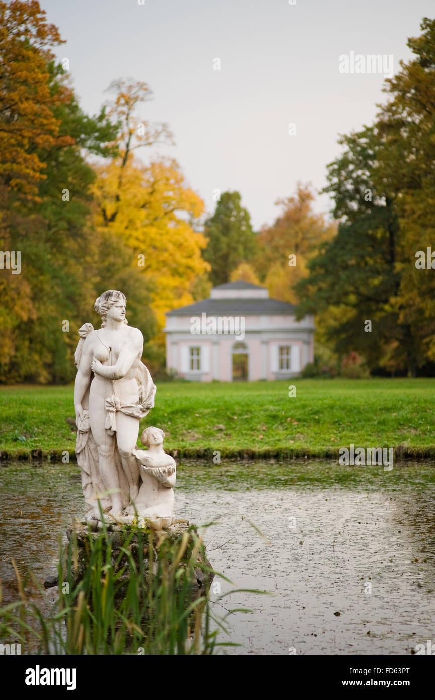Autumn trees in grounds of Schloss Fasanerie near Fulda in Germany Statue at lakeside in grounds of Schloss Fasanerie - Stock Image