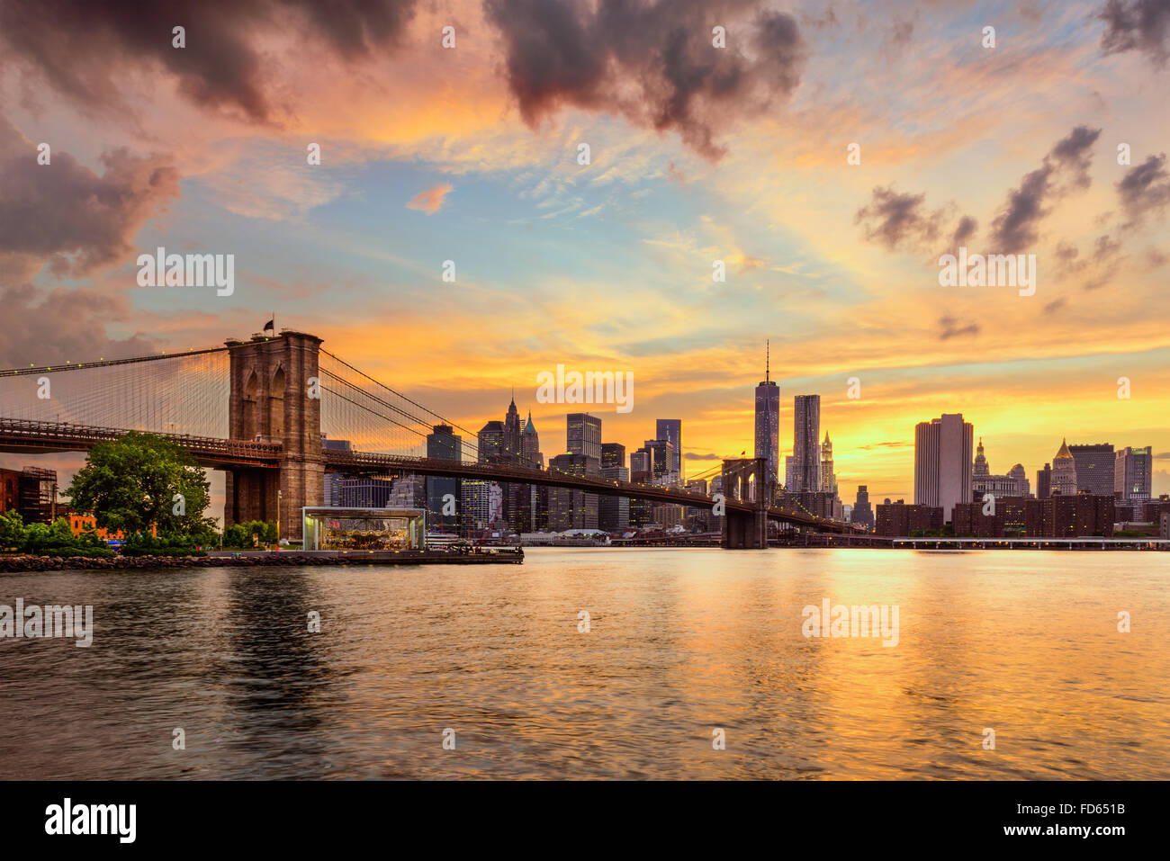 New York City, USA skyline from the East River and Brooklyn Bridge. - Stock Image