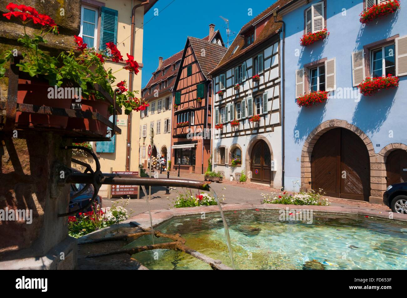 France, Haut Rhin (68), Eguisheim village (elected most beautiful french village), Stumpf street, fountain //  Haut Stock Photo