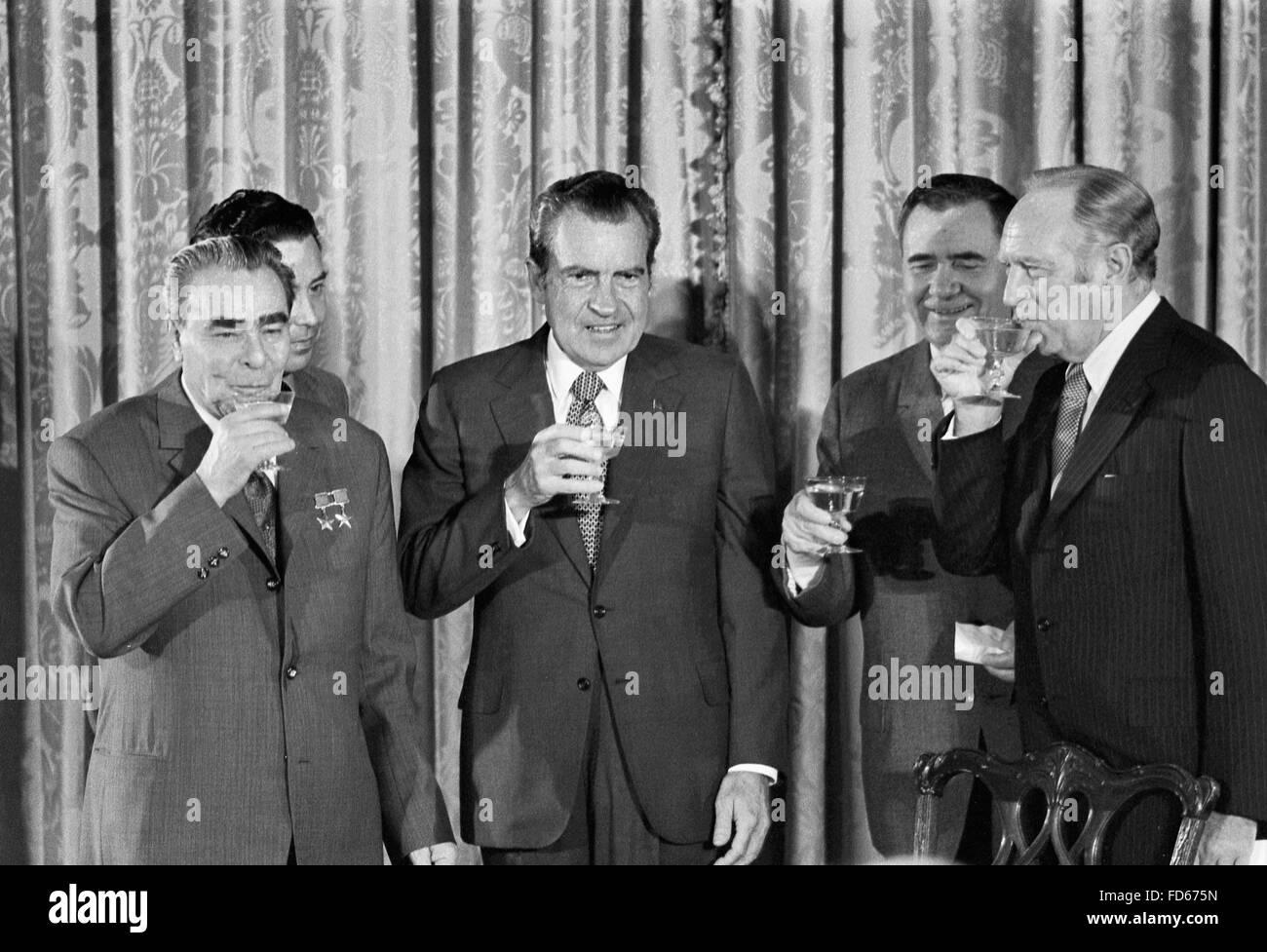 Nixon and Breshnev. President Richard Nixon with (left to right) Soviet leader Leonid Brezhnev, Soviet Minister - Stock Image