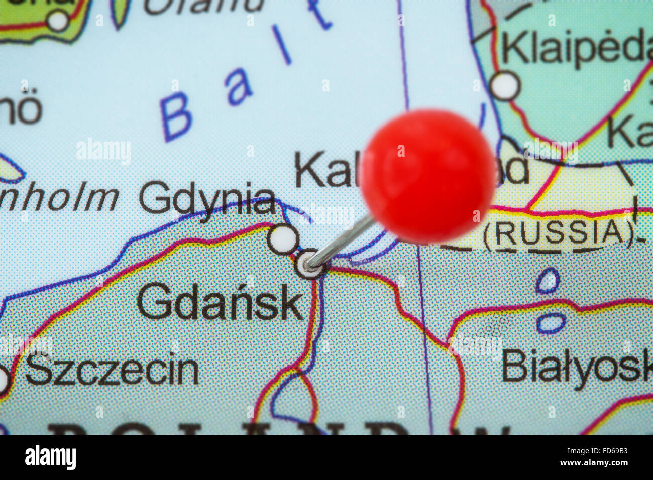 Closeup of a red pushpin in a map of Gdansk Poland Stock Photo