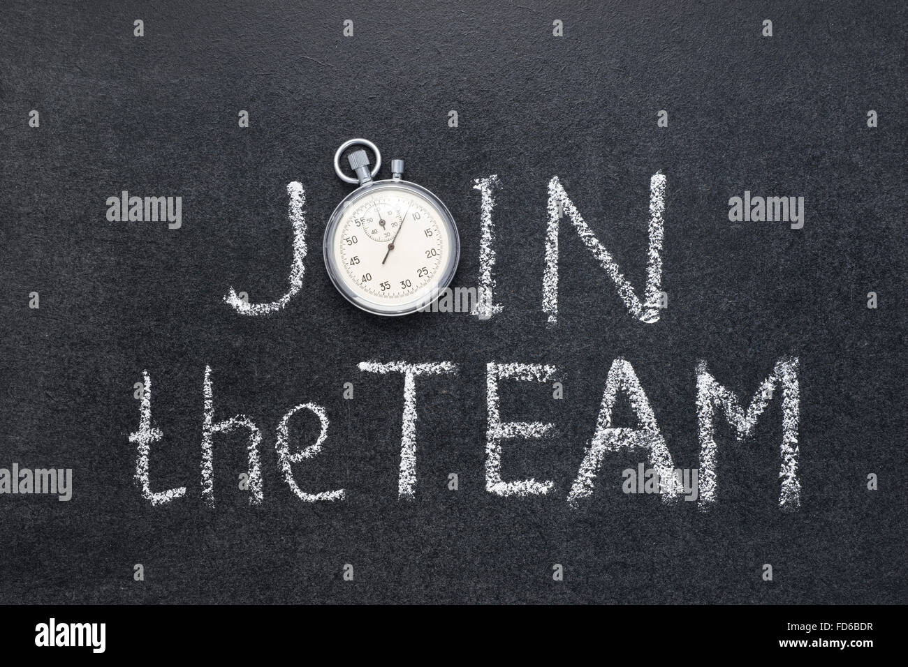 join the team phrase handwritten on chalkboard with vintage precise stopwatch used instead of O - Stock Image