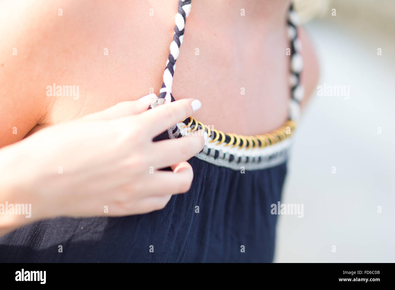 Midsection Of Woman Adjusting Sundress Stock Photo
