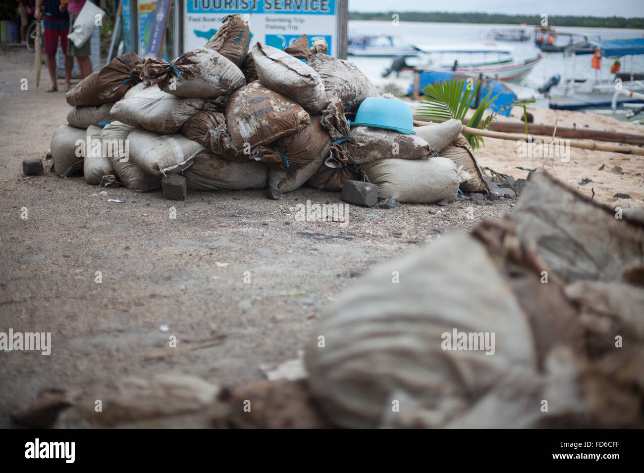 Heap Of Sacks On Sand At Beach - Stock Image