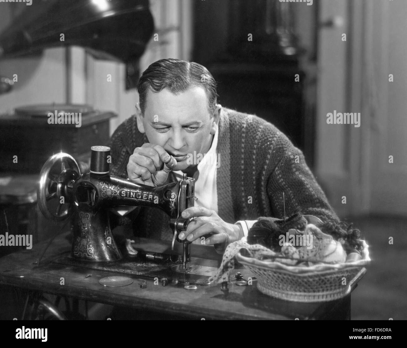 Man at a sewing machine, 1930s - Stock Image