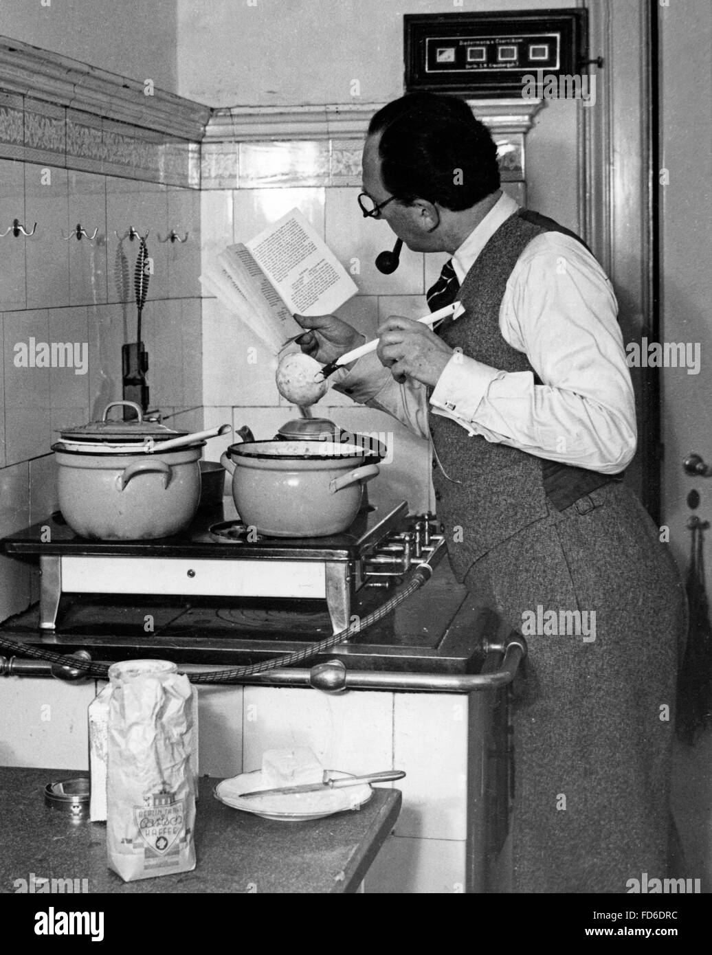Men on household chores until 1990 - Stock Image