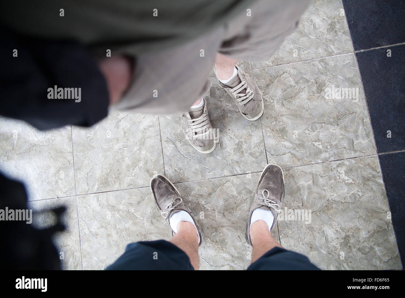 High Angle View Of Human Feet - Stock Image
