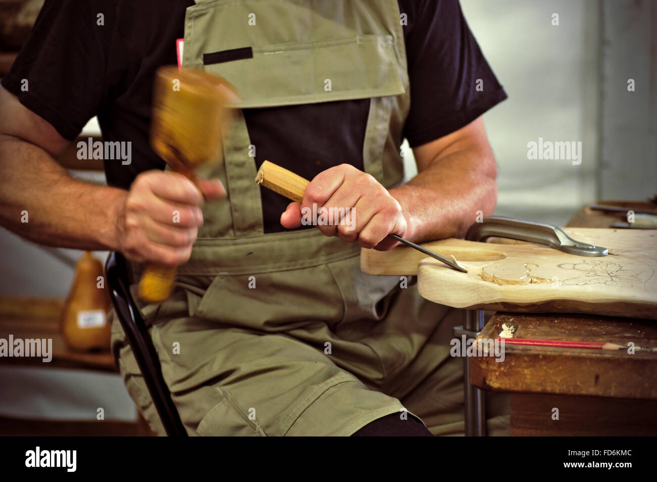 Midsection Of Craftsperson Shaping Wood - Stock Image