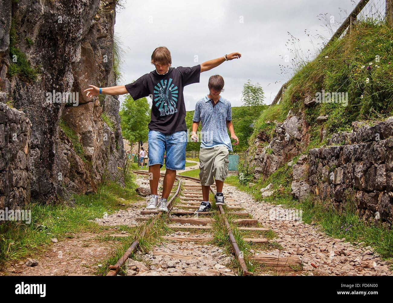 Teenage Boys Playing On Railroad Track - Stock Image